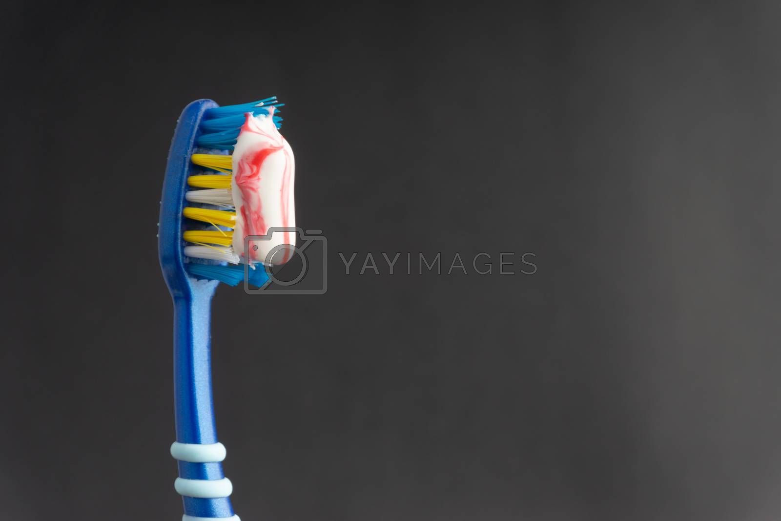 Toothbrush closeup on white background. Healthy concept