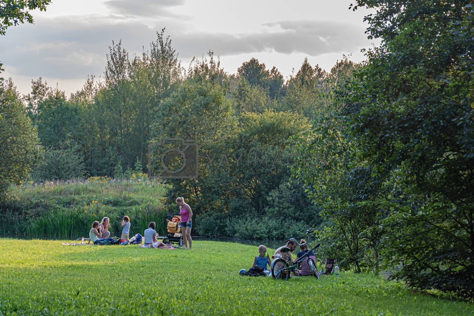 Royalty free image of Russia, Moscow-08/20/2016: Family vacation on the green grass ne by Grommik