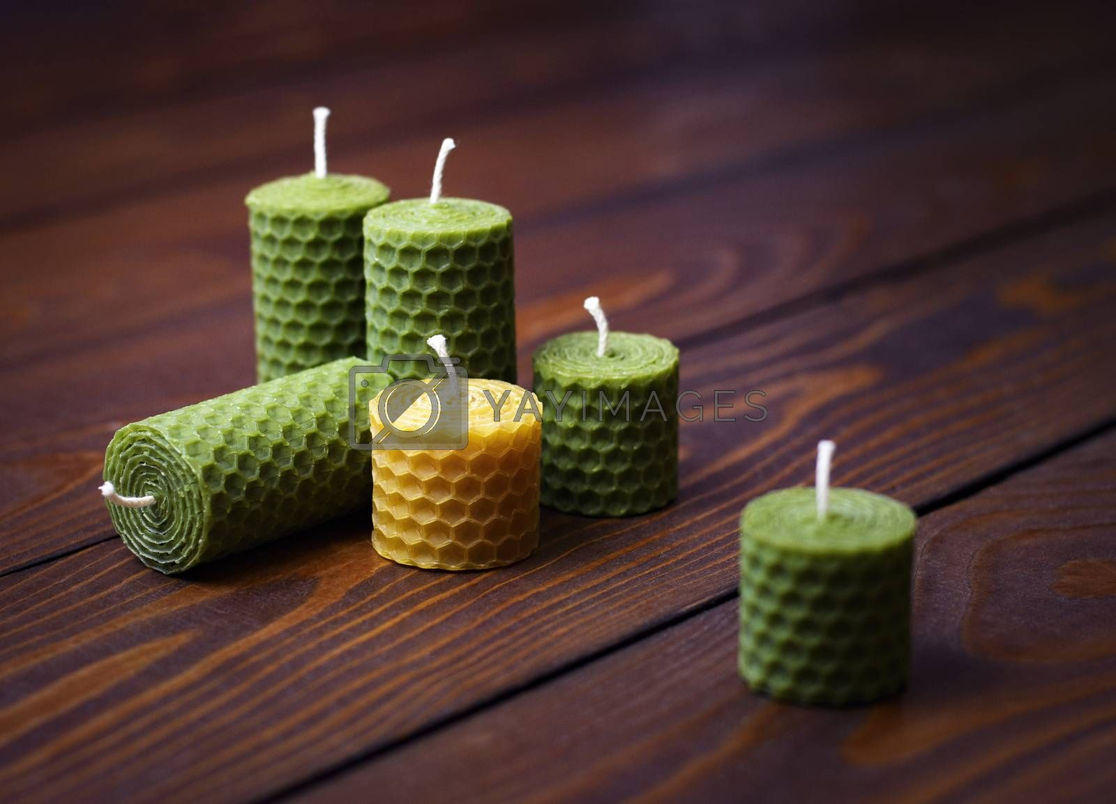 background beeswax candles on a dark wooden table