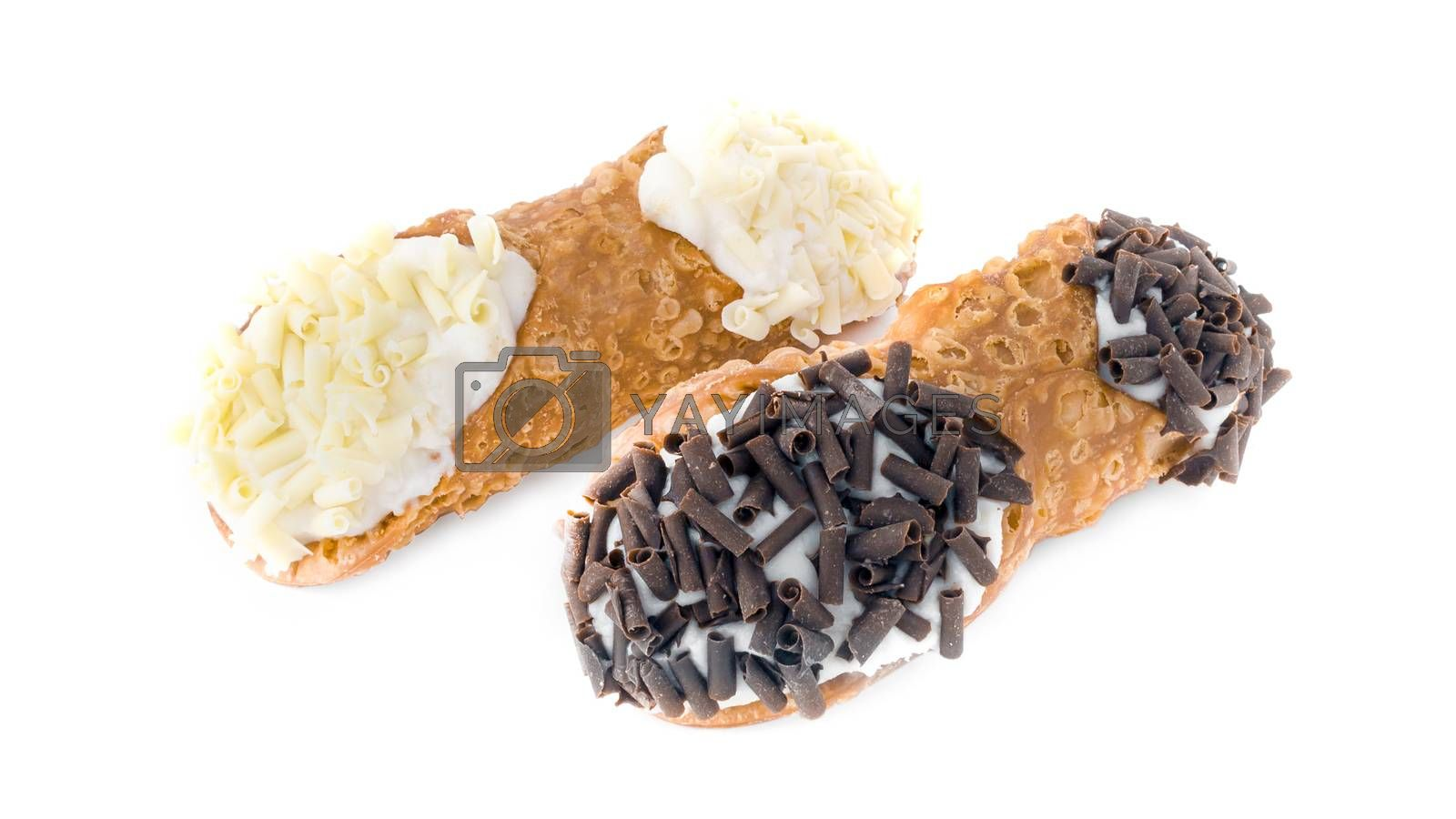 Sicilian cannoli. Three cannoli pastries. Traditional Sicilian dessert, filled with a rich ricotta cream  enriched with pistachio grain, hazelnut grain and chocolate flakes.