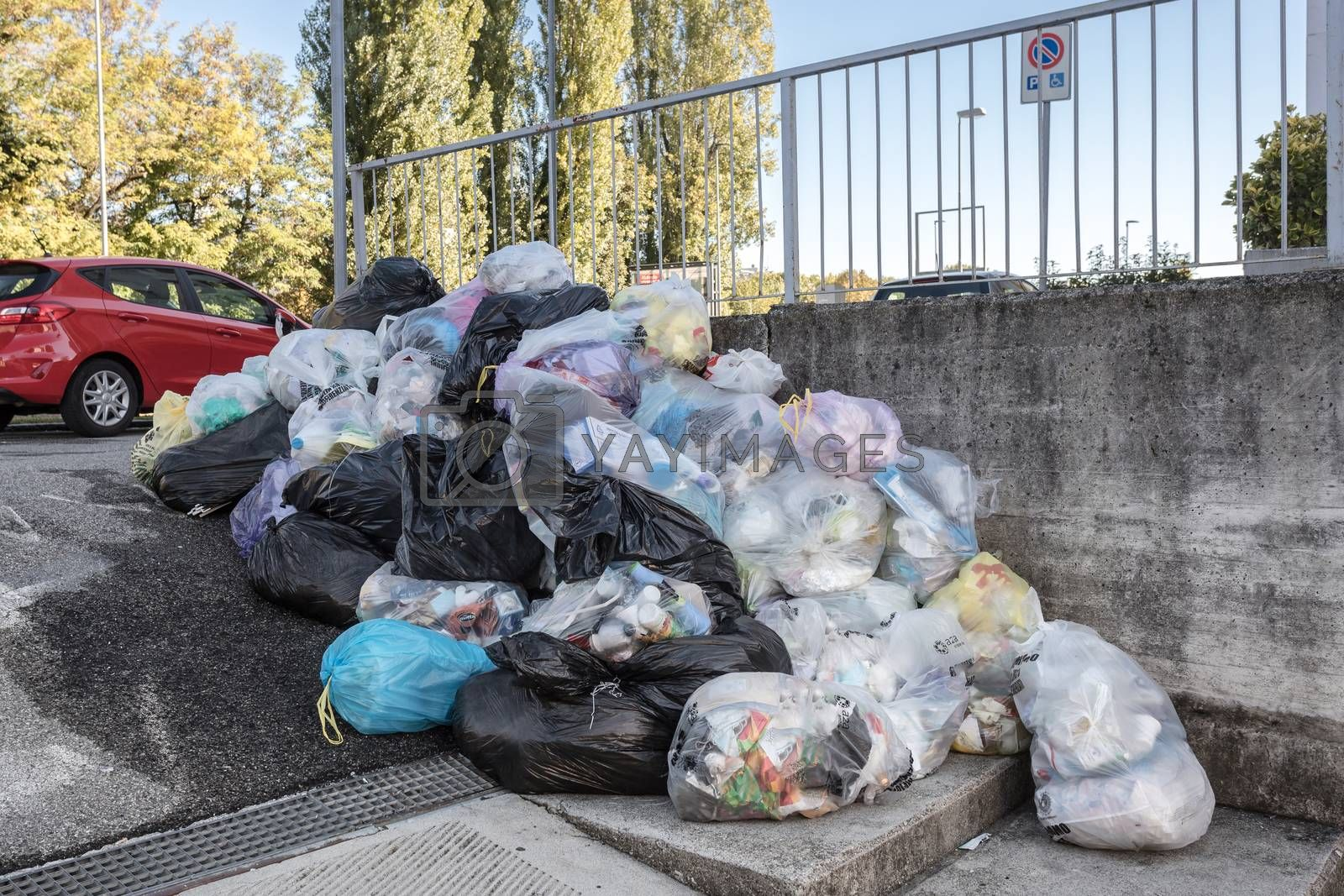 Road and footpath full of garbage / Dirty street. Bergamo, ITALY - October 12, 2020.