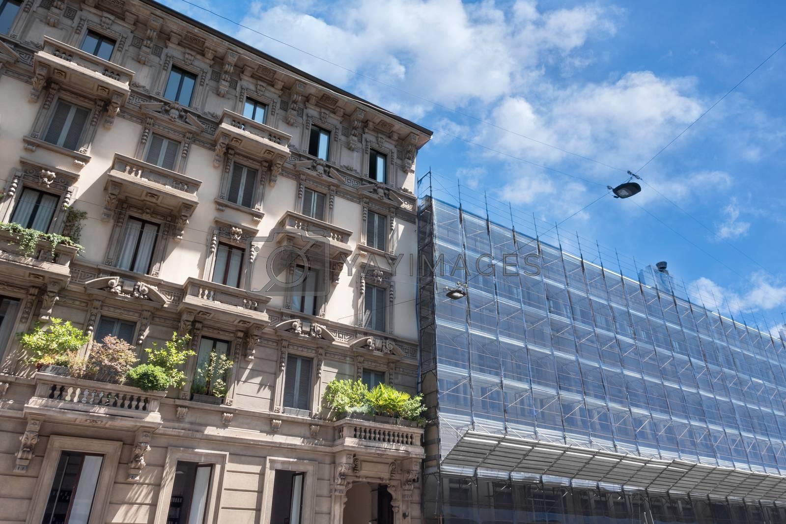 Scaffolding on a historic Italian palace, building under renovation.
