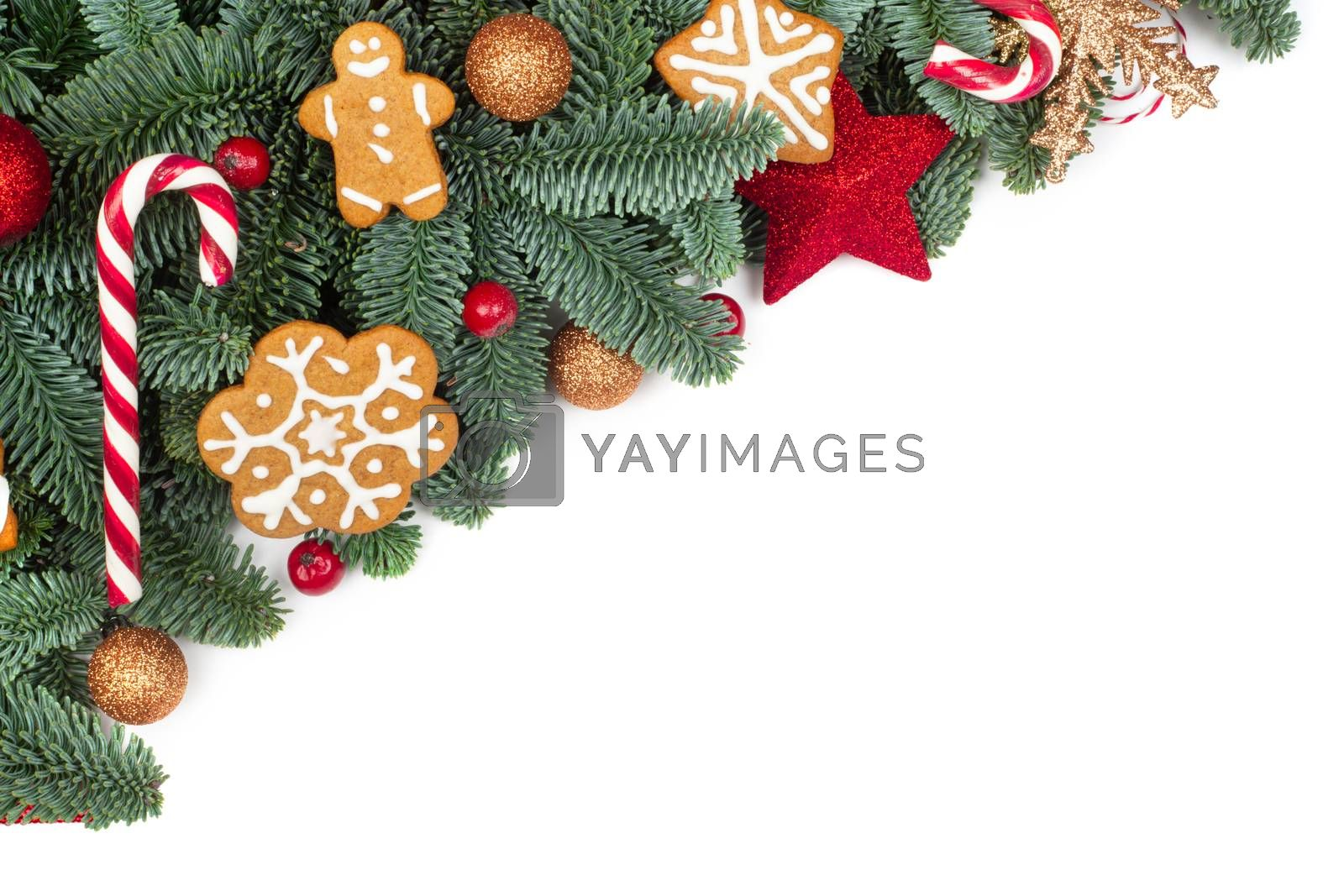 Christmas design boder frame greeting card of noble fir tree branches cookies and baubles isolated on white background
