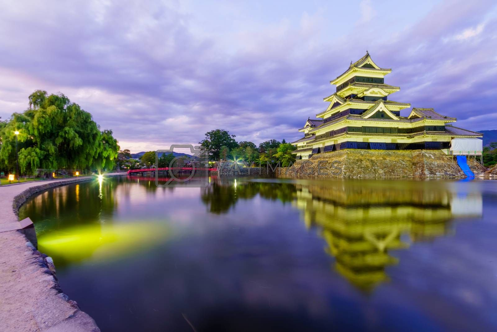 Night view of the Matsumoto Castle (or Crow Castle) and bridge, in Matsumoto, Japan