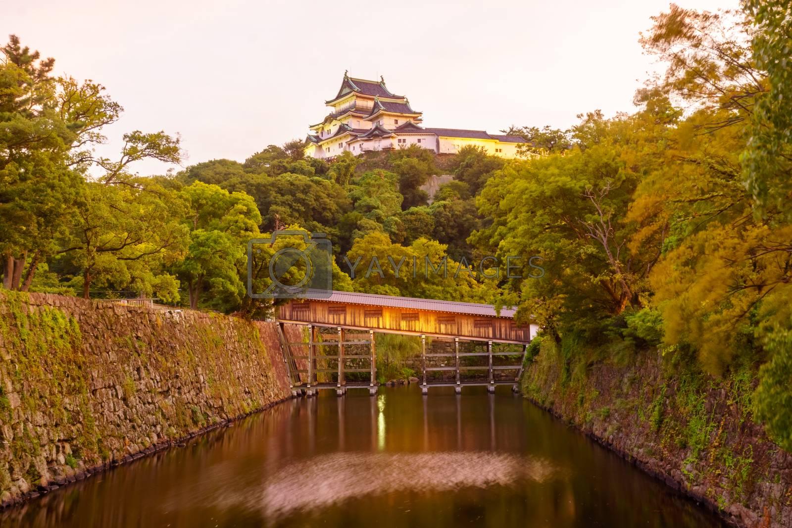 Sunset view of the Wakayama castle and the Ohashirouka Covered Bridge, in Wakayama City, Japan