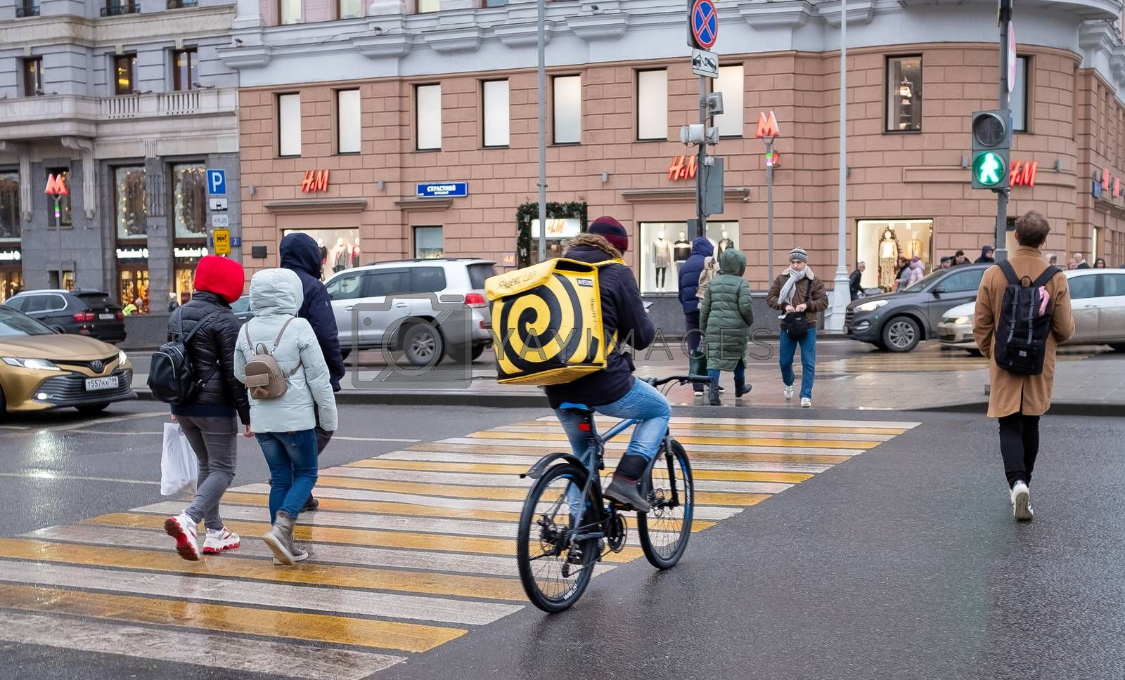 January 21, 2020 Moscow, Russia. An employee of the Yandex Food delivery service on a Moscow street.
