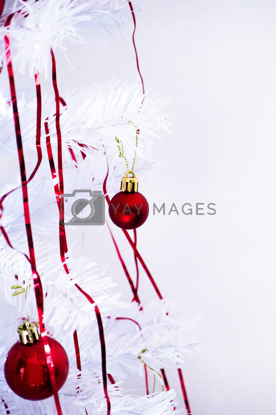 White christmas tree with red decorations. No people