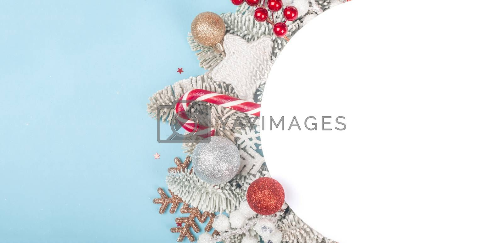 Royalty free image of Frost fir tree and Christmas decor by destillat