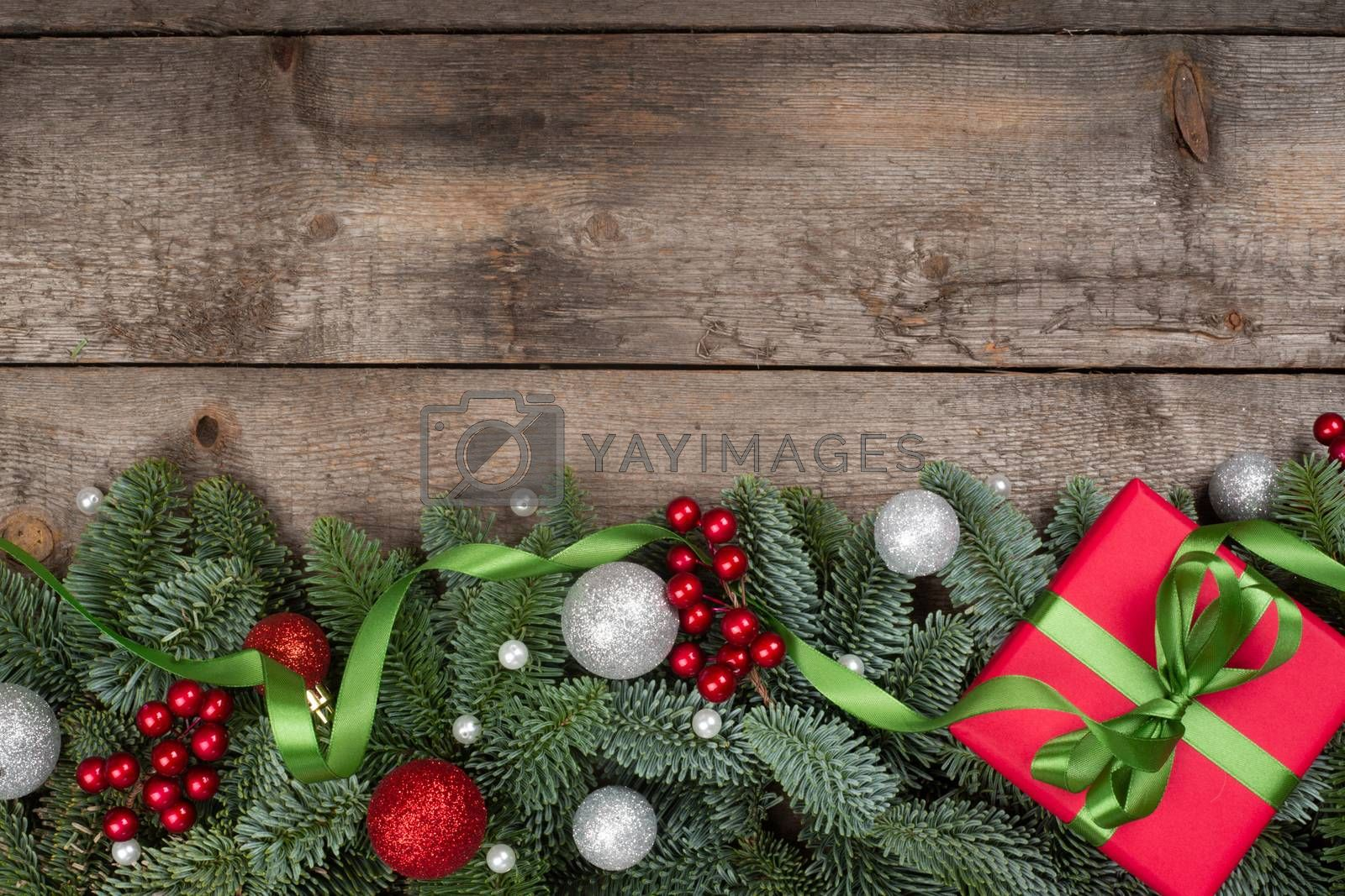 Royalty free image of Christmas gift and fir branches by destillat