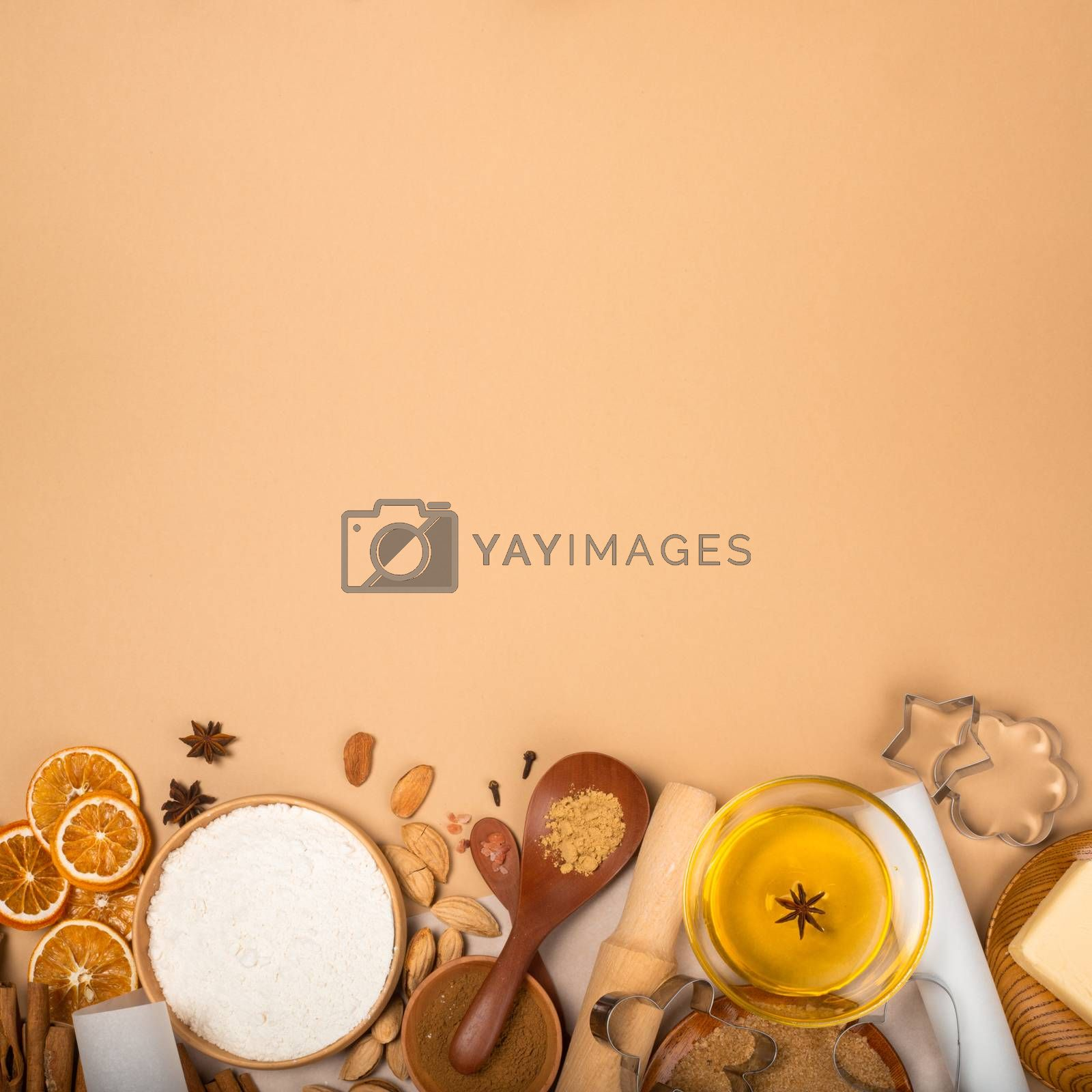 Christmas gingerbread cookies cooking background flat lay top view template with copy space for text. Baking utensils, spices and food ingredients on brown paper background
