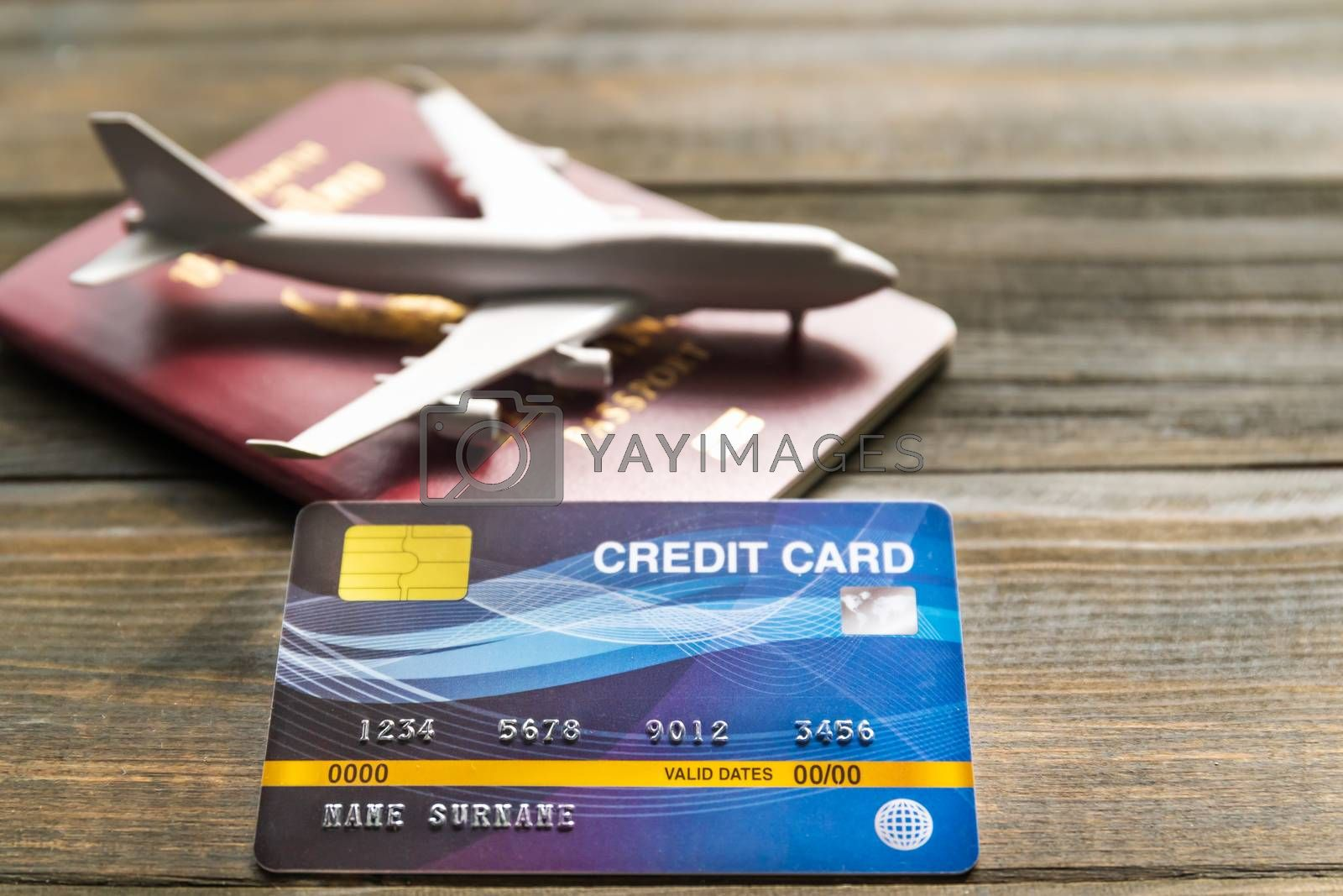 Credit card put on  wooden desk with passport and plan, Preparation for Traveling concept
