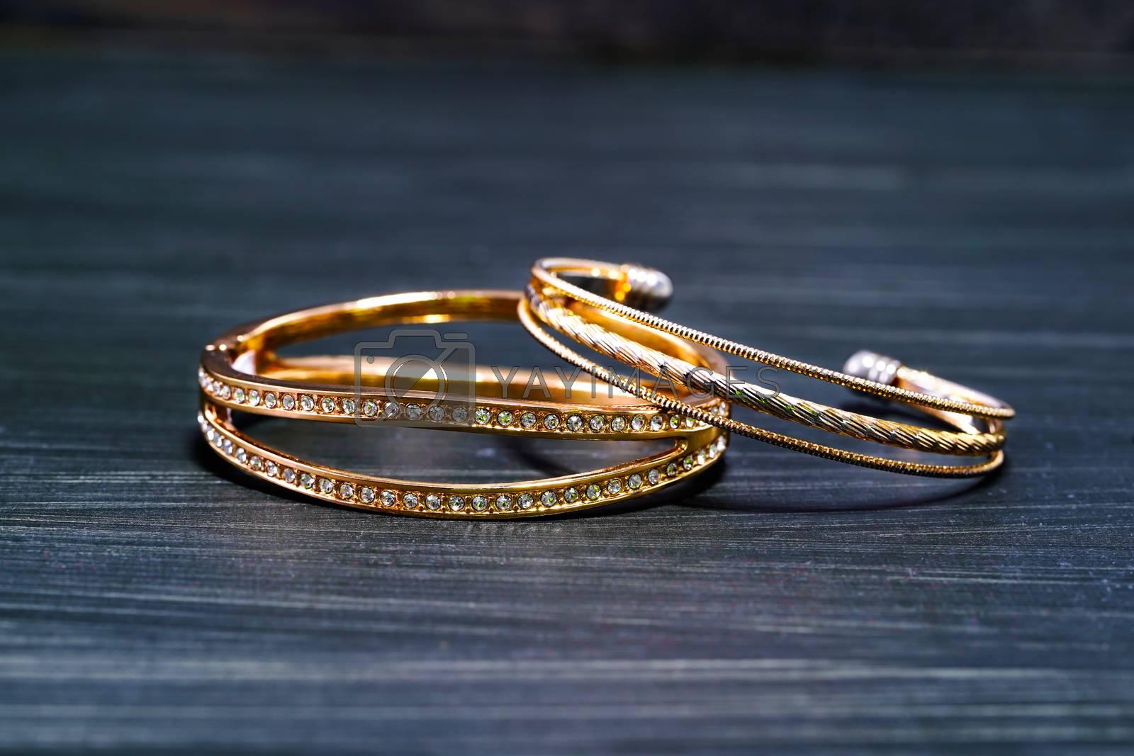 Closeup Gold ring diamond gem. Gold wedding rings with diamond