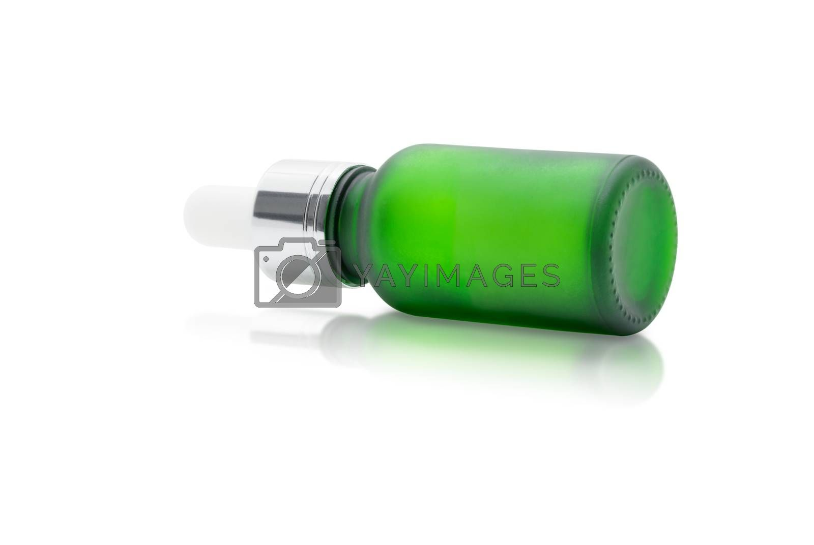 Green glass dropper serum bottle on white background, Mockup for cosmetic product design