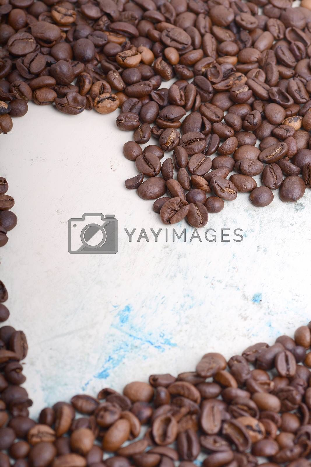 Coffee beans background. Roasted aromatic brown coffee beans close up