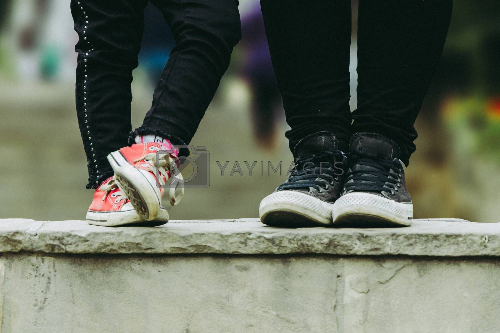 Cropped image of mother and daughter, mom and daughter slippers