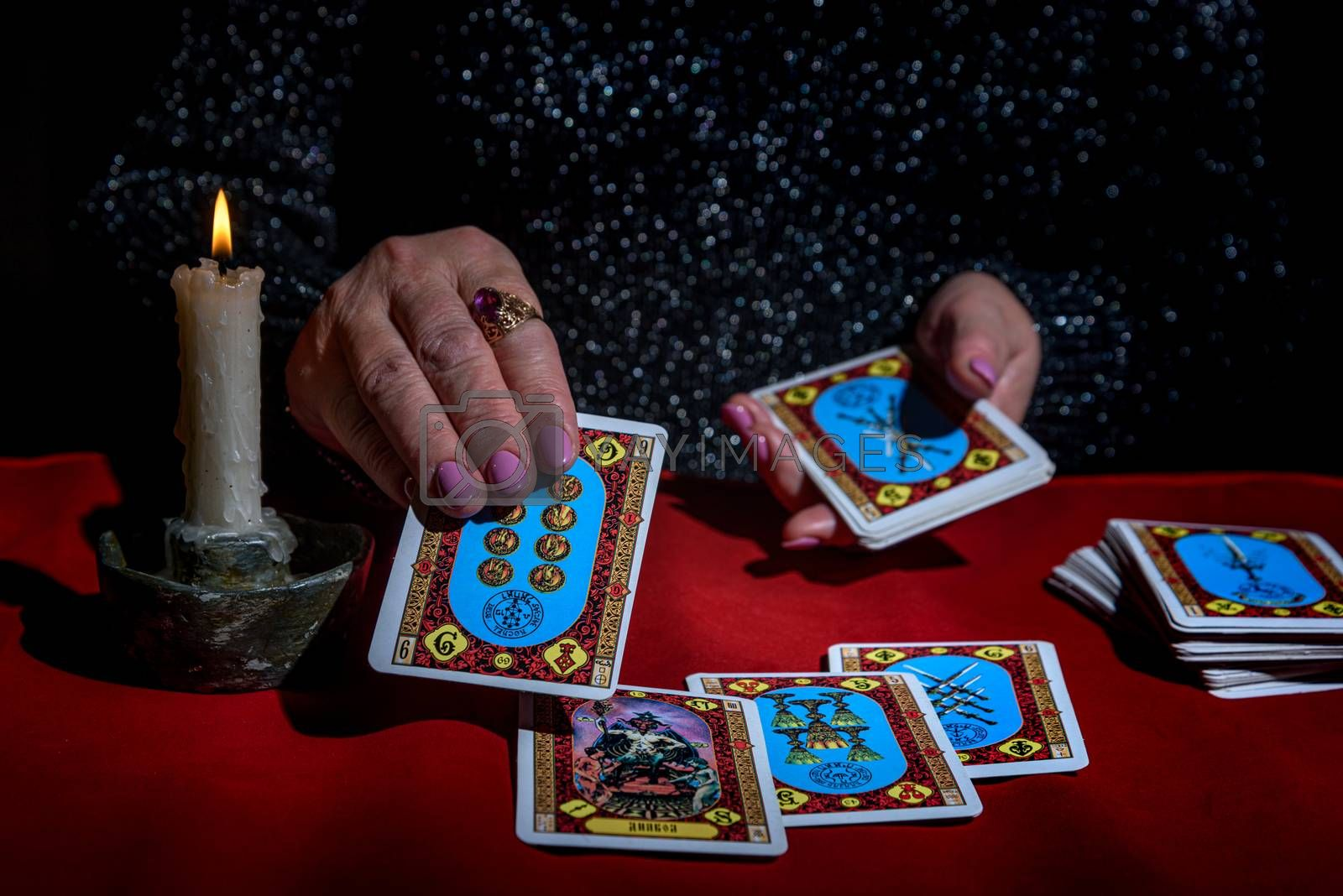 Royalty free image of A woman reads Tarot cards by VladimirZubkov