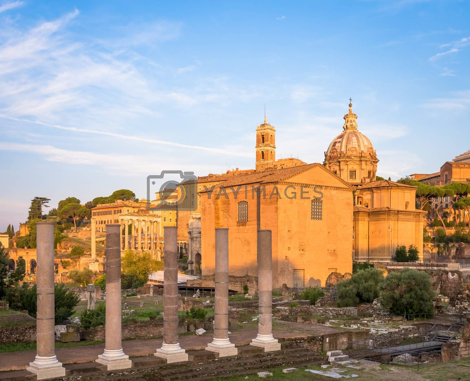ROME, ITALY - CIRCA AUGUST 2020: sunrise light with blue sky on Roman ancient architecture.