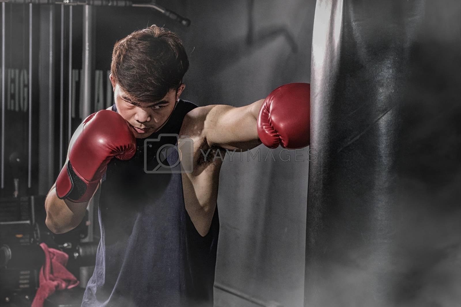 Boxer hitting a huge punching bag at a boxing studio