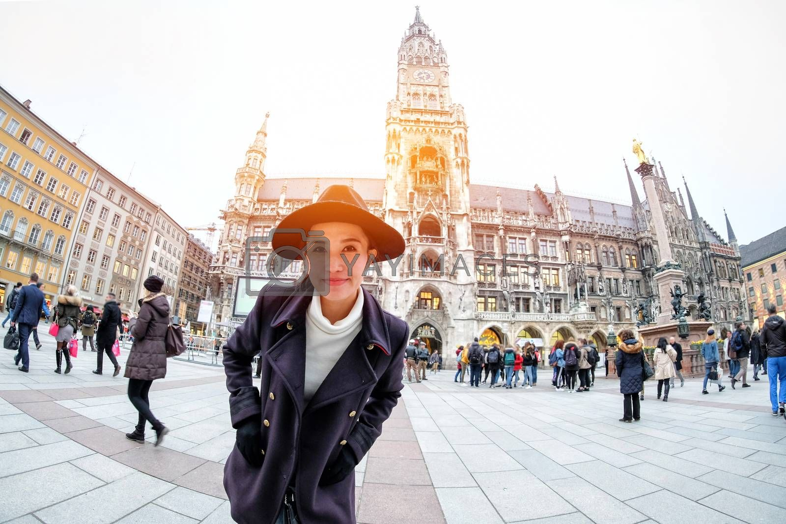 Young Woman Tourists selfie with mobile phone near the  Marienplatz town hall and Frauenkirche in Munich, Germany