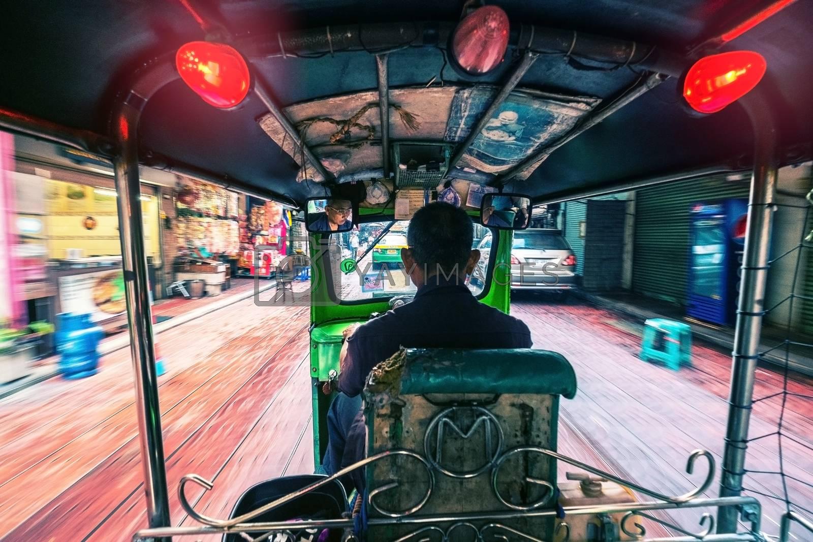 BANGKOK - JANUARY: Tuk - tuk on Chinatown street at daylight on Jan 09, 2016 in Bangkok Thailand