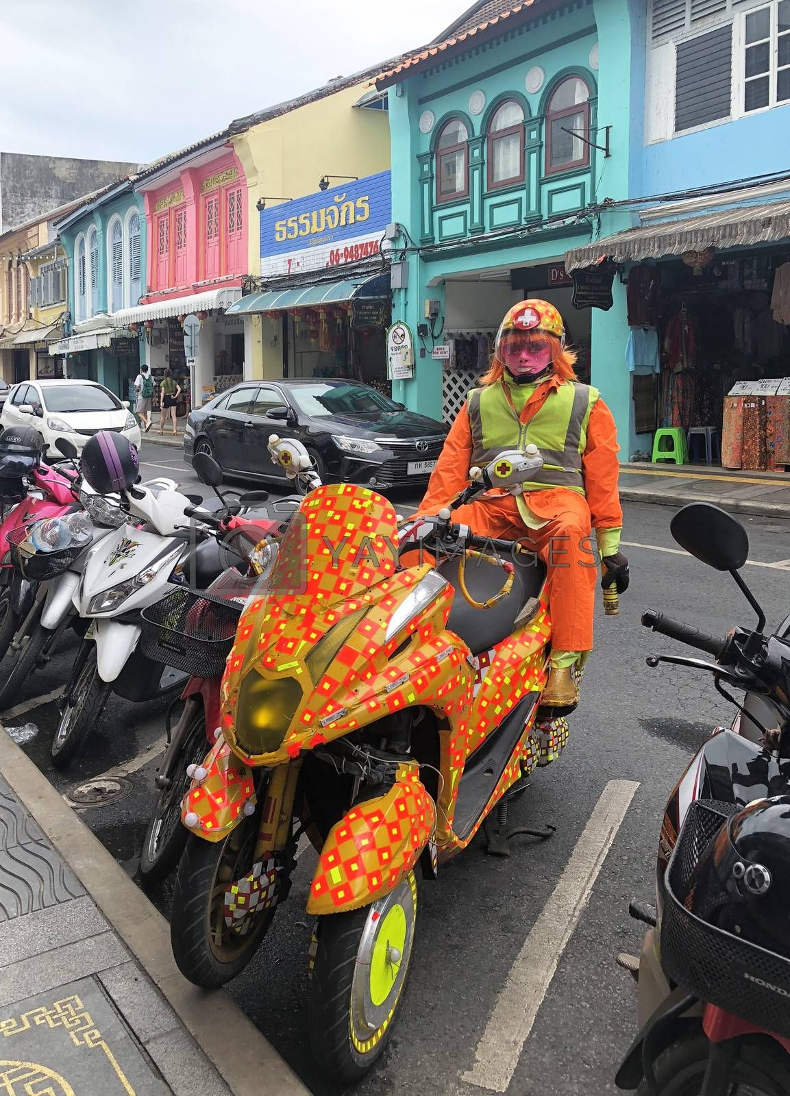 Phuket Thailand 30 May 2018 : Colorful Robot Security in Phuket Walking Sreet at daylight in Phuket Old Town. View of the street food market at dusk with a crowd of locals and tourists.