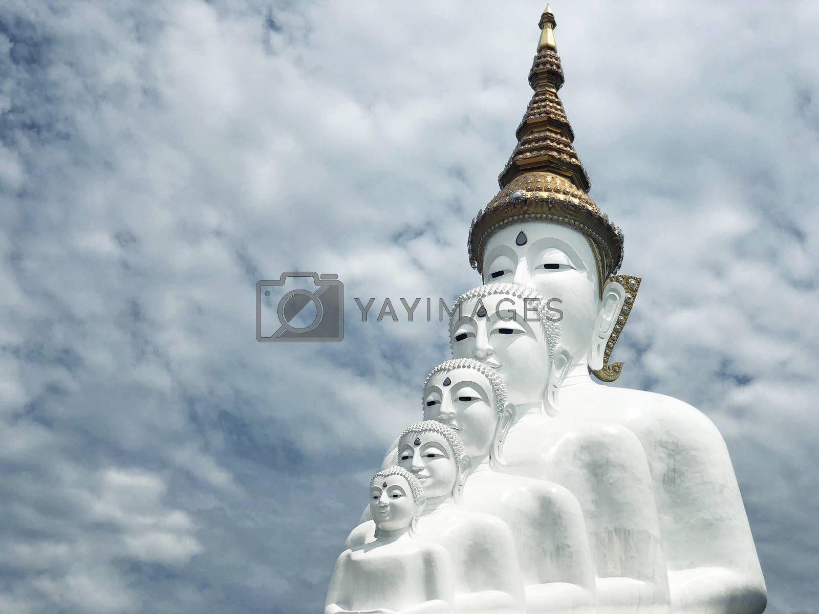 White Buddha Statue and cloud background at Wat Prathat Phasornkaew Thailand