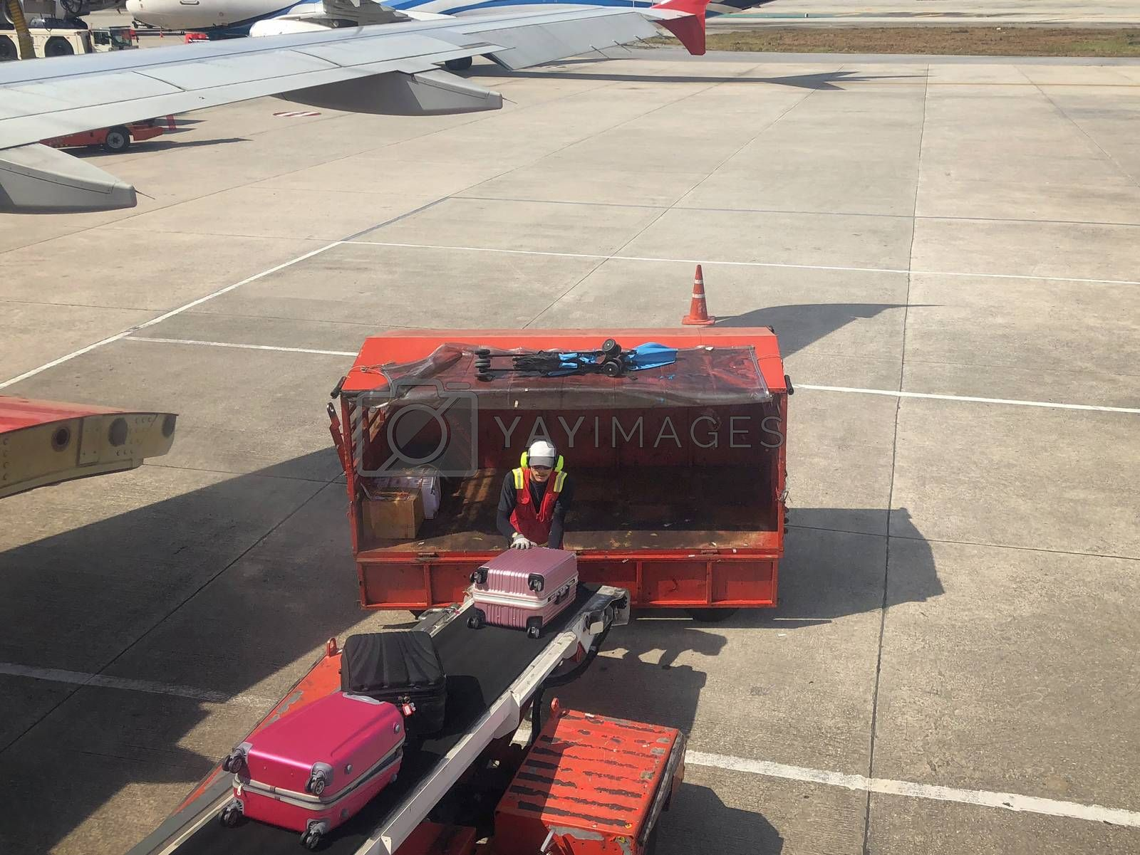 Baggage handlers working at Don Mueang International Airport