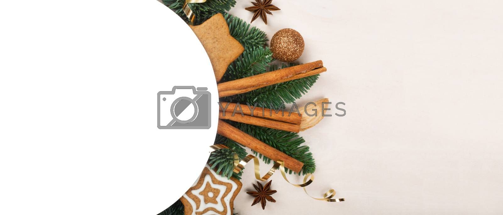 Christmas circle frame of natural fir tree branches and gingerbread cookies with copy space for text