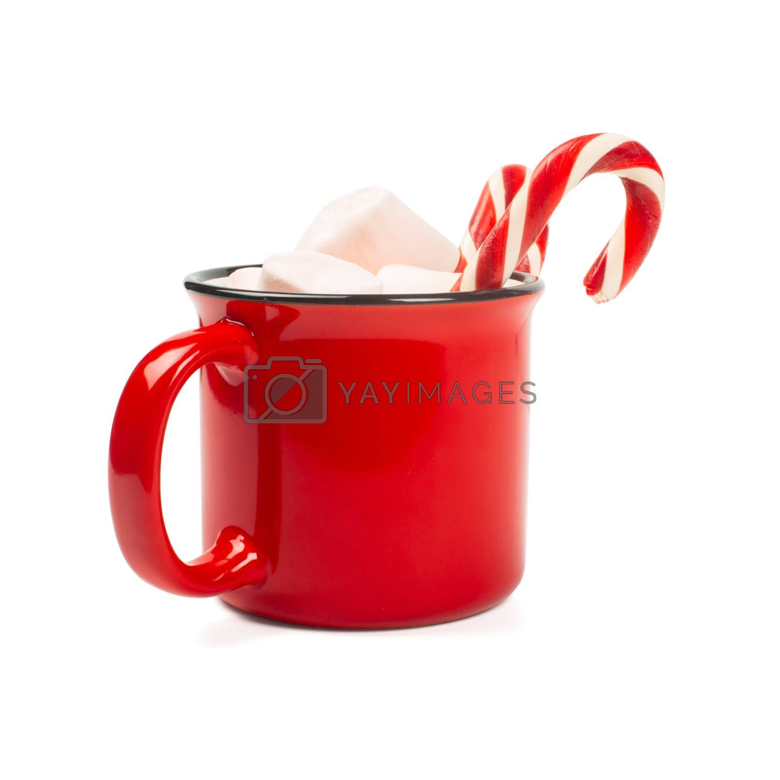 Cocoa in red mug with marshmallows and candy cane isolated on white background