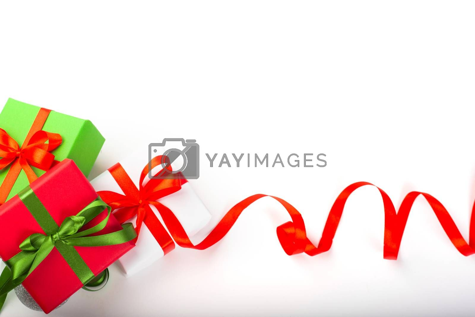 Holiday present gift boxes with red satin bow and curly ribbon border frame design isolated on white background , Christmas, Valentines day