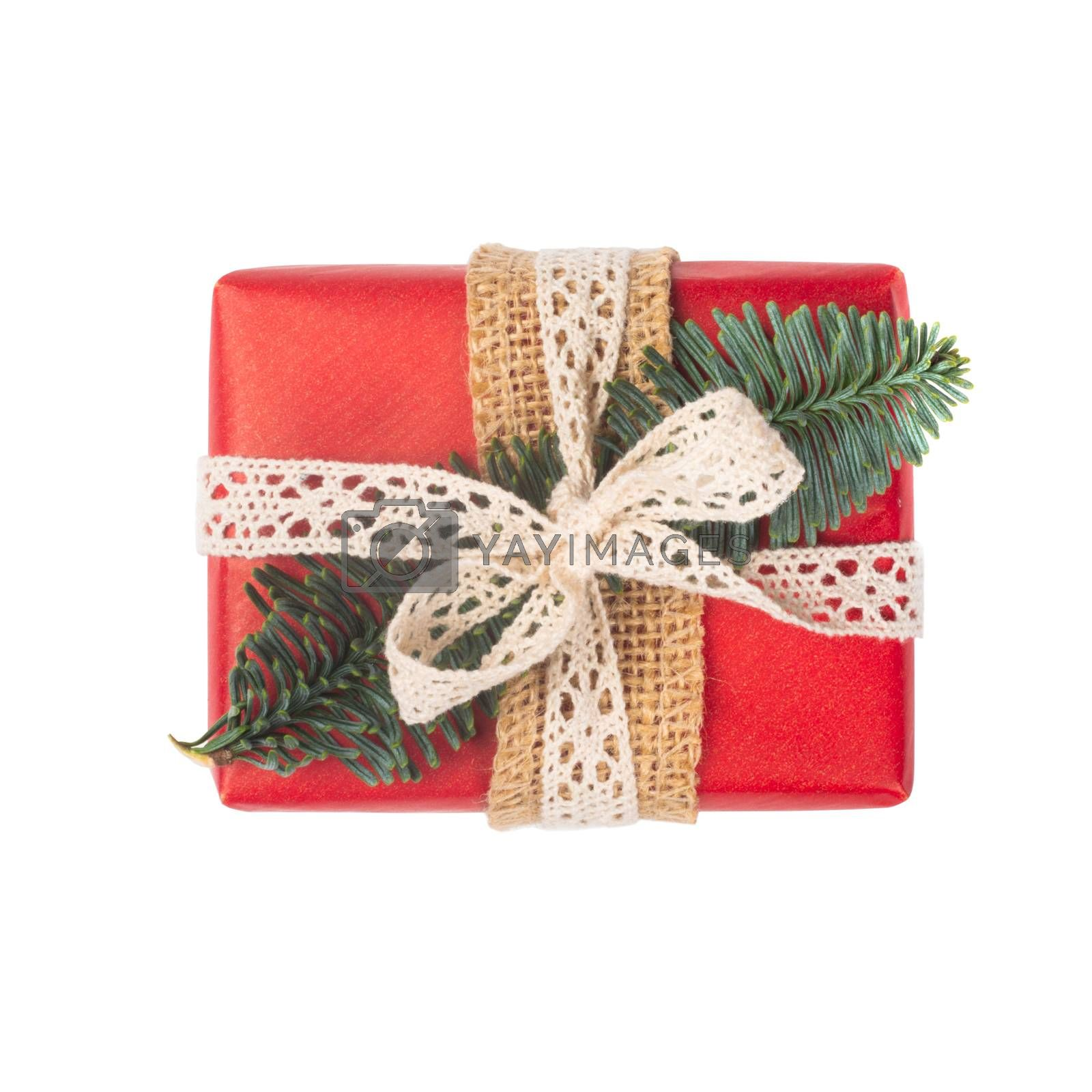 Wrapped vintage christmas gift box with red ribbon bow, isolated on white