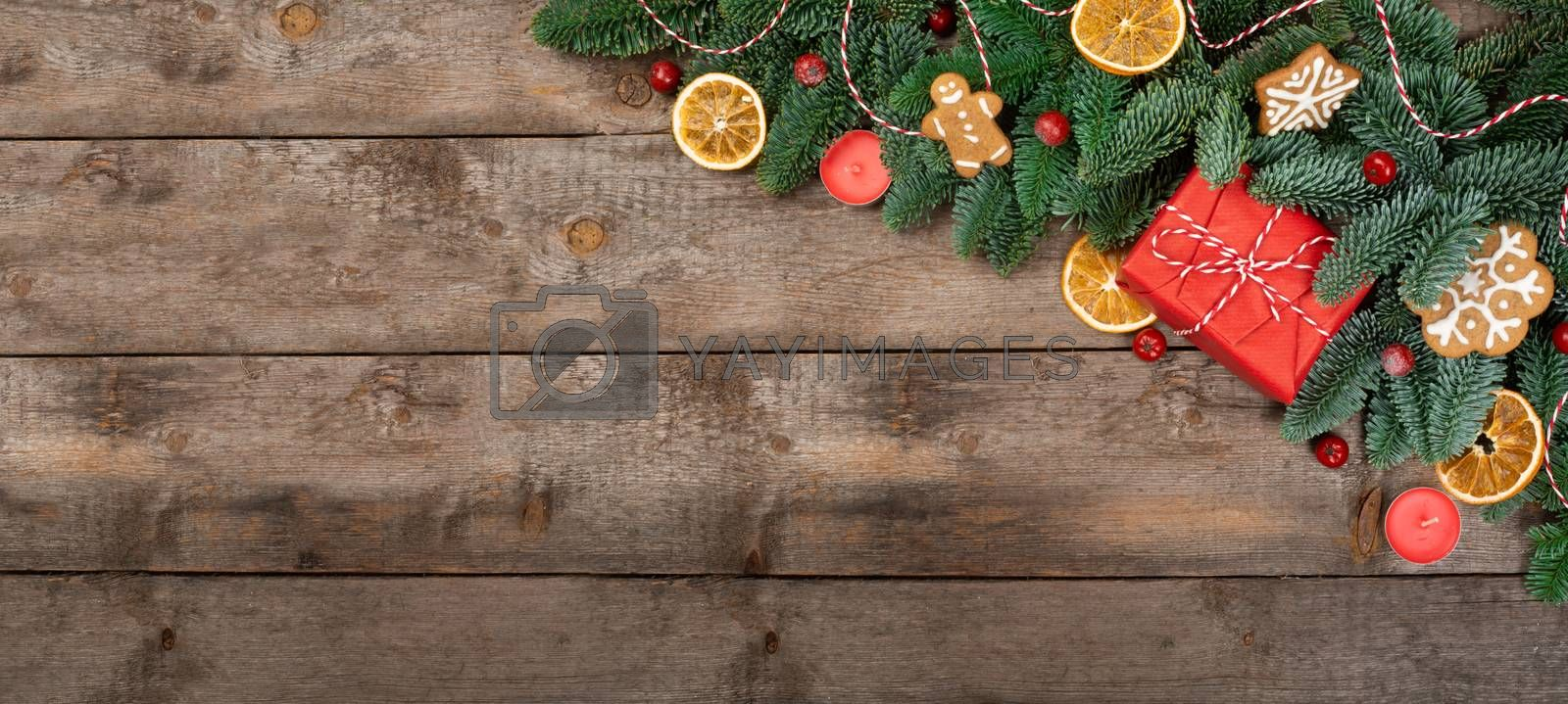Christmas or New Year background composition made of Xmas decorations gingerbread cookies and fir tree branches and gift with copy space for text
