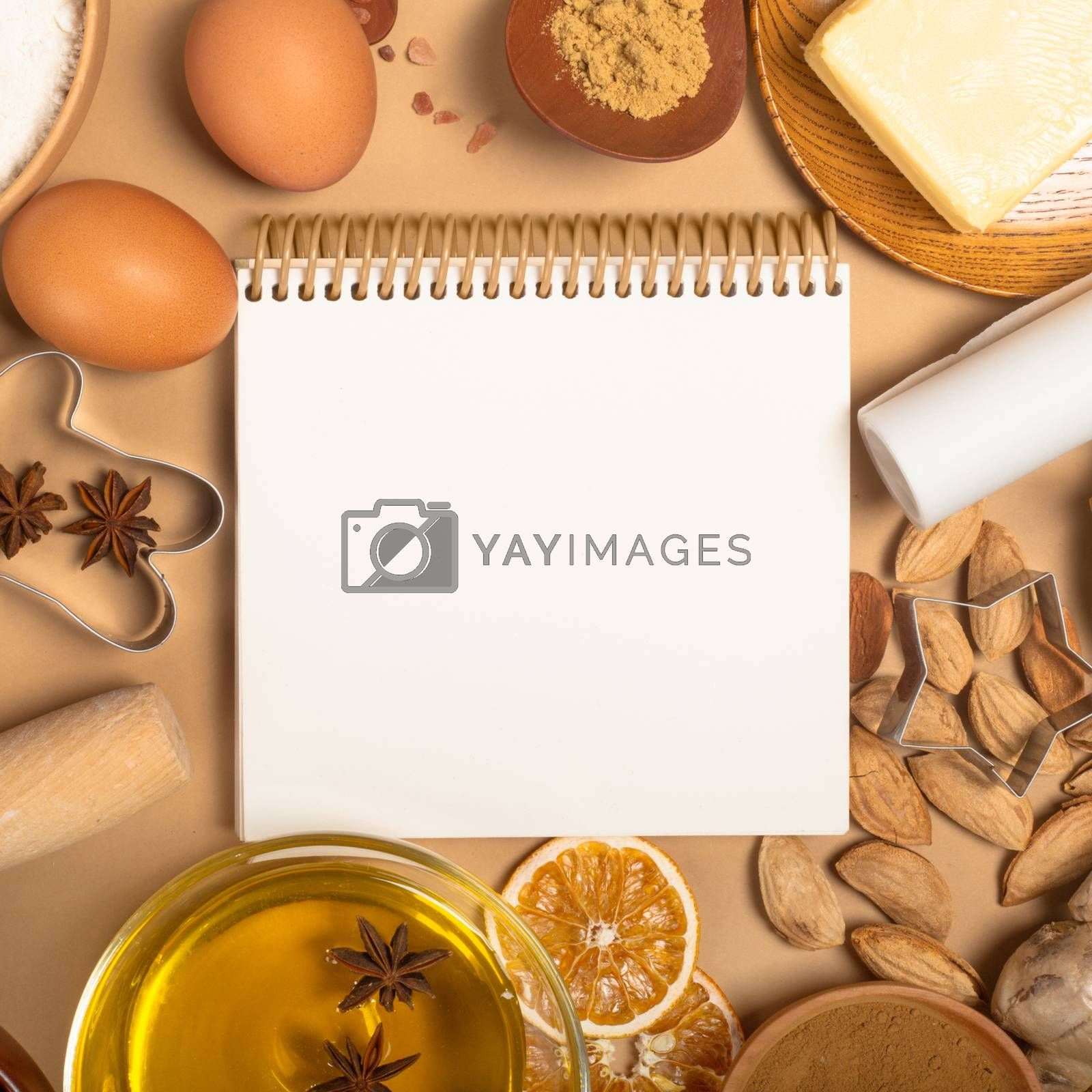 Christmas gingerbread cookies cooking background flat lay top view template with copy space for text. Baking utensils, spices , food ingredients and recipe book