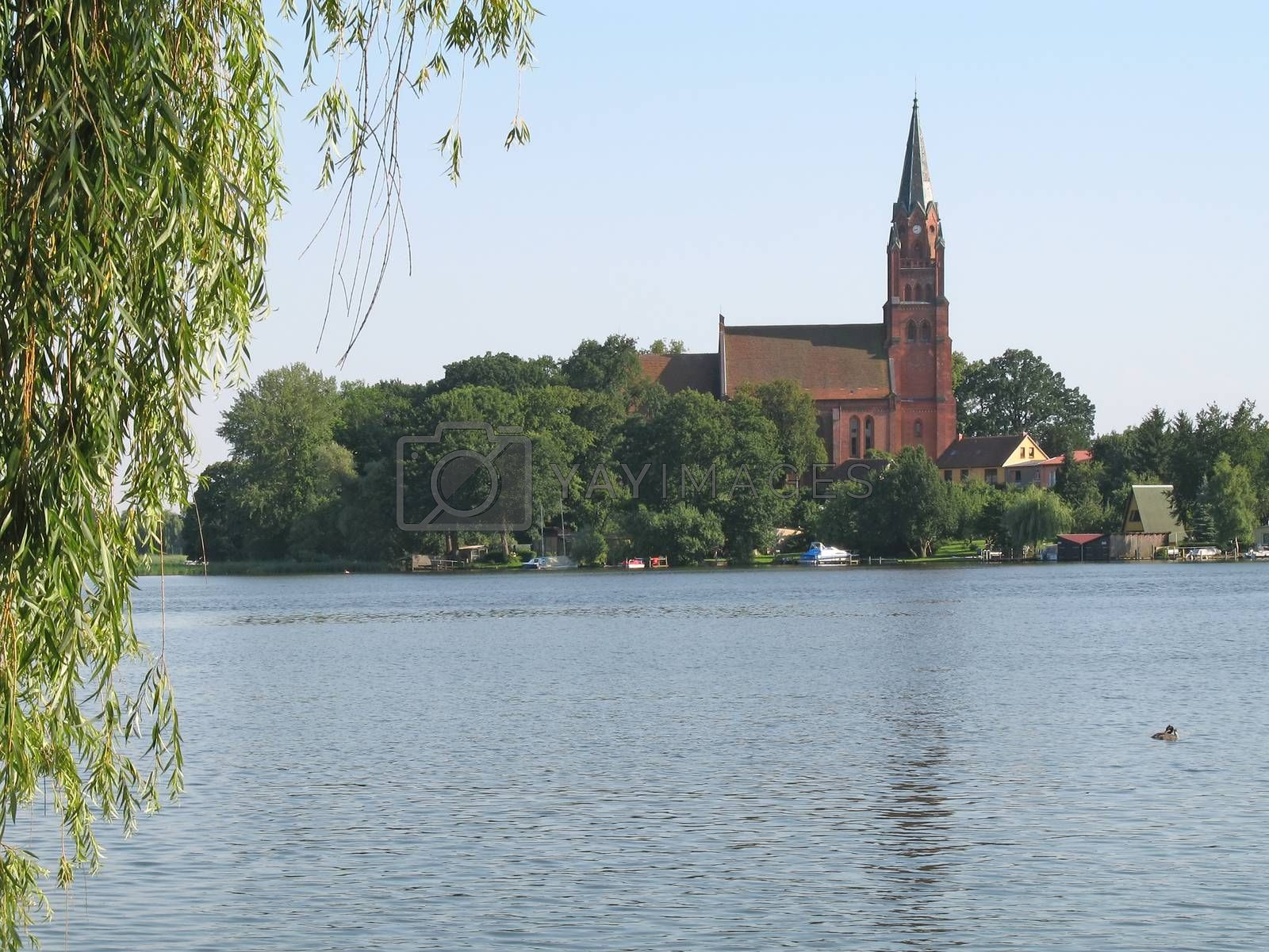 View onto the lake Mueritz and St. Marien Church in Roebel, Mecklenburg-Western Pomerania, Germany.