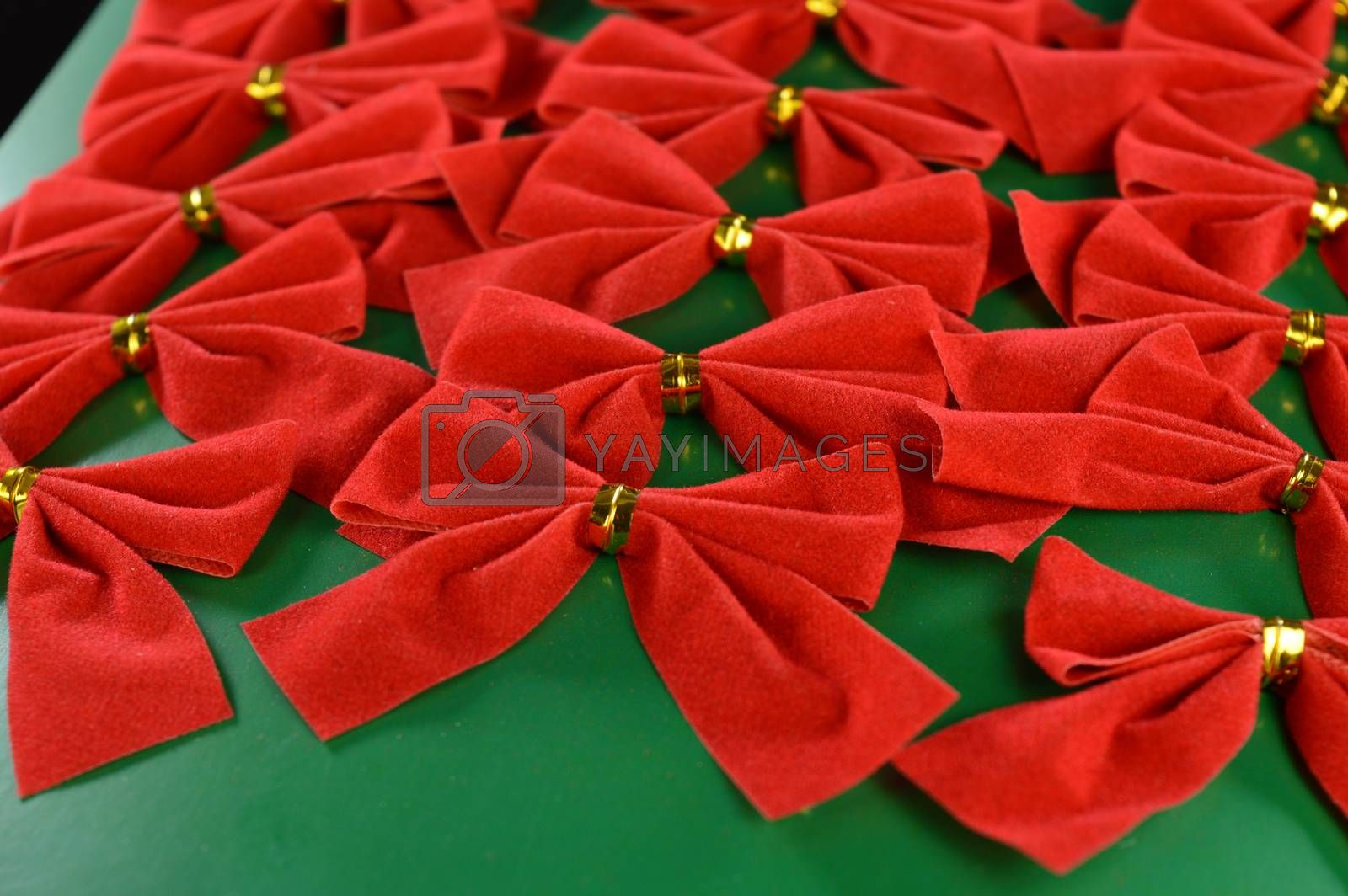 A full set of packaged decorative red bows used during the Christmas holiday season for dressing up the tree or gifts.