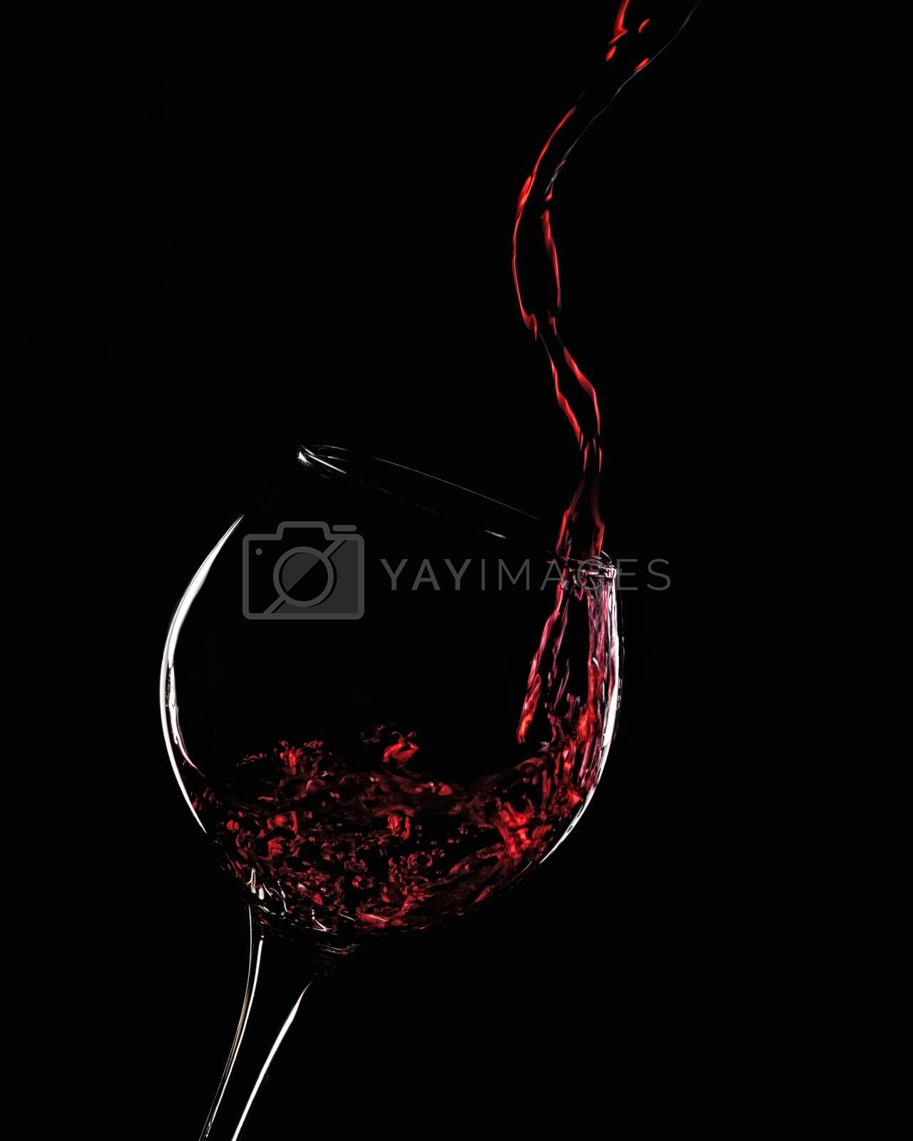 Royalty free image of A splash of red wine in a glass by VladimirZubkov
