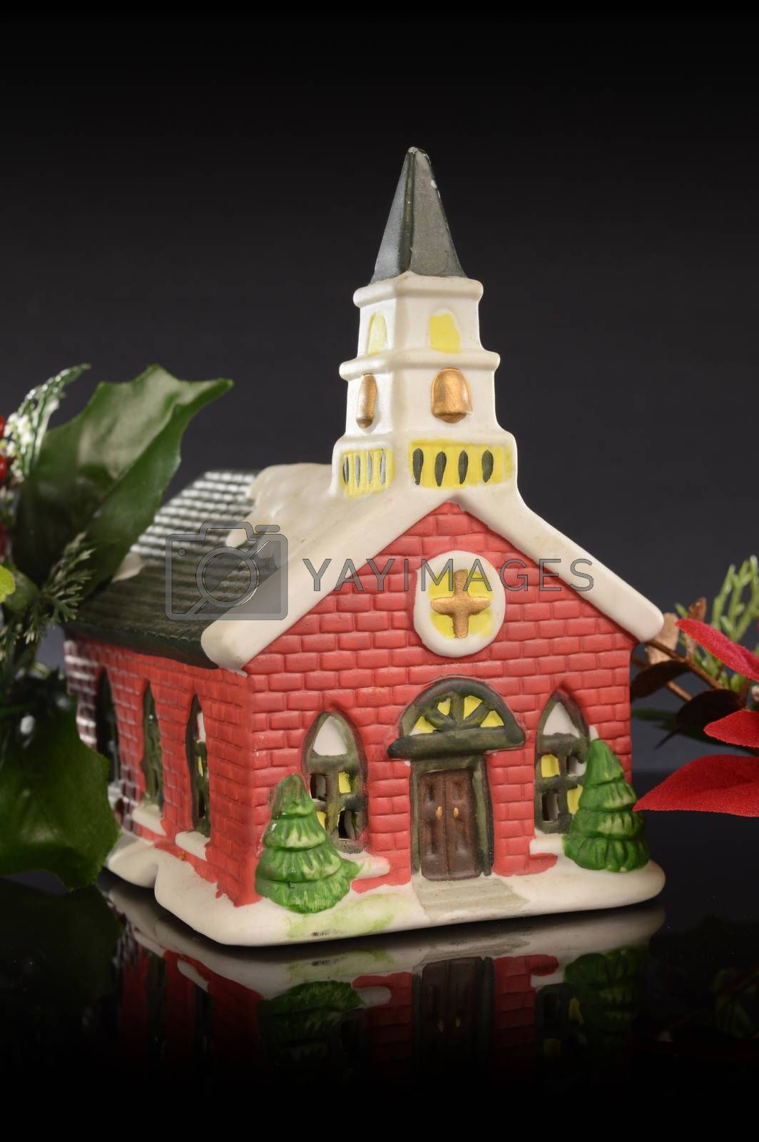 A closeup image of a Christmas church scene decorated for the holiday season.