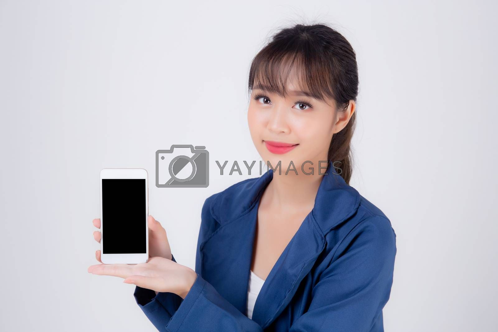 Beautiful portrait young business asian woman show blank smart mobile phone isolated on white background, businesswoman presenting smartphone for advertising, girl holding phone, communication concept.