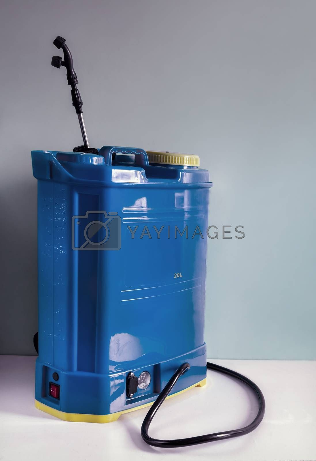 Backpack battery sprayer for protecting trees and plants from diseases and pests. The pressure is increased using a battery-powered pump. Close-up, copy space