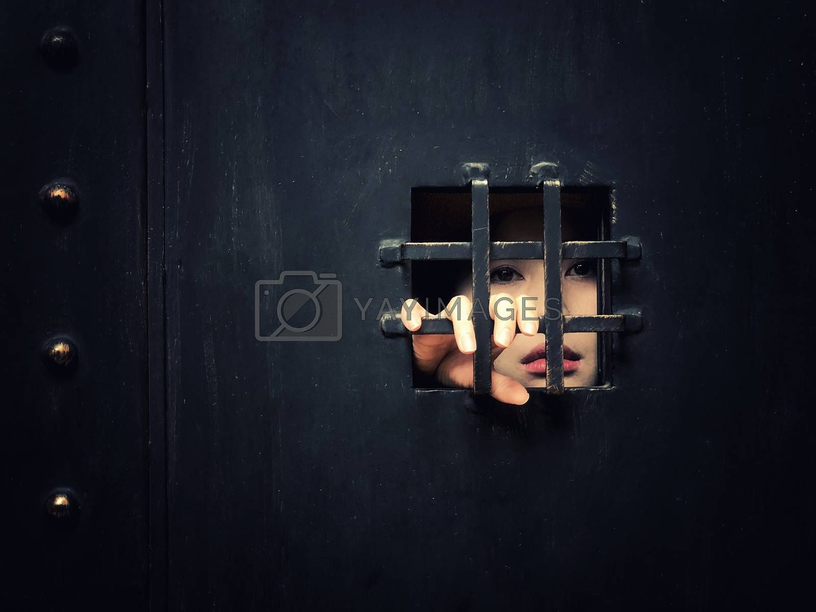 Horror woman locked in dark cage hand holding cage scary scene halloween concept