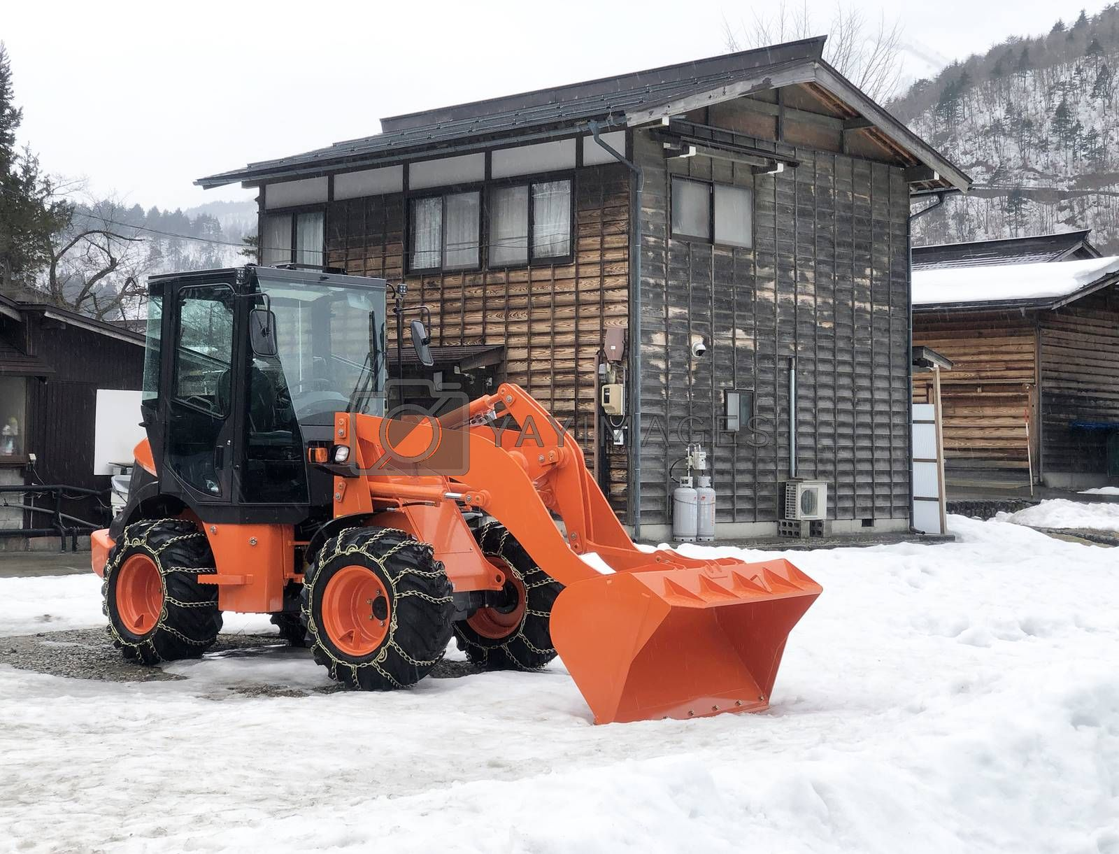 Orange Snowplow Truck Remove the Snow in Shirakawago, Japan