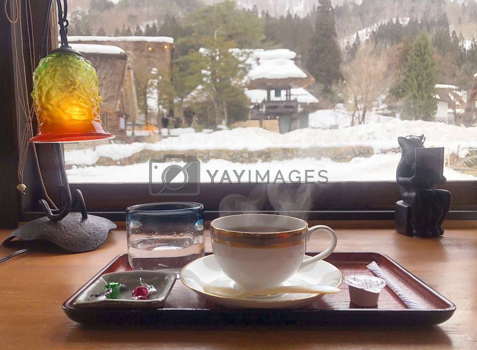 Coffee in the morning  and enjoying the winter snow view at Shirakawago village, Gifu, Japan.