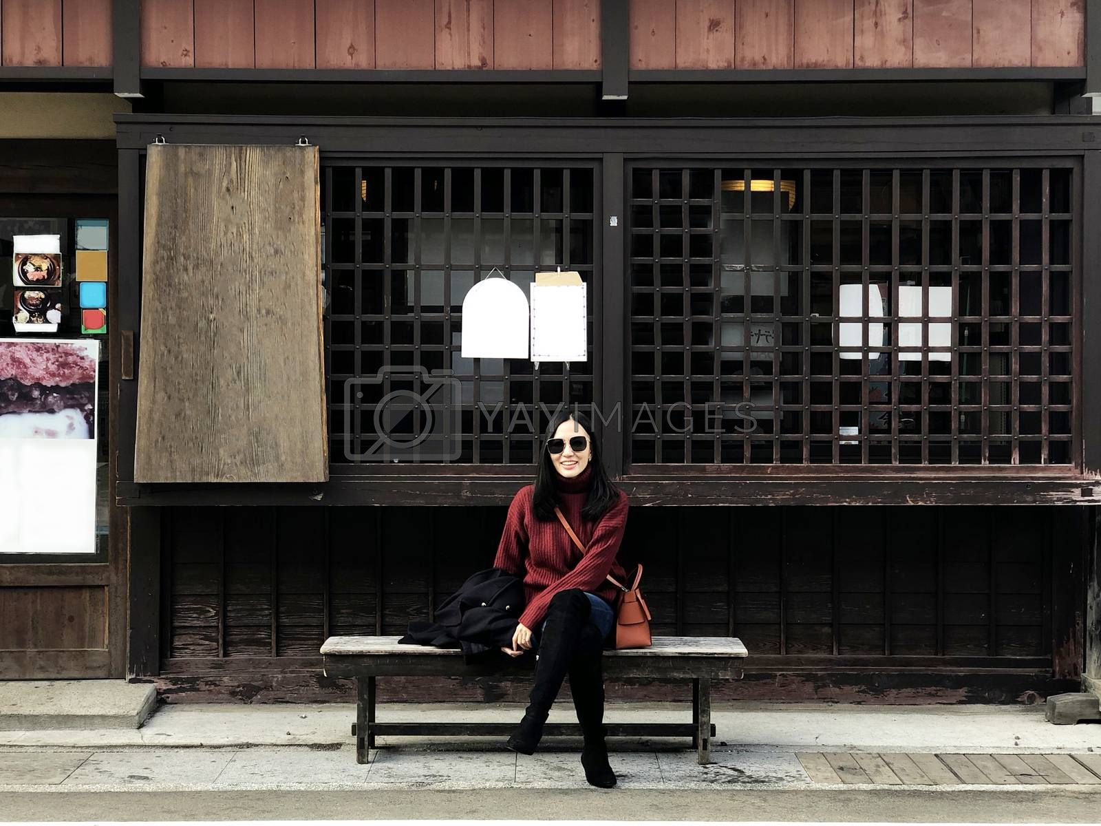 Happy woman tourist enjoy view in old twon street city of Takayama, Japan
