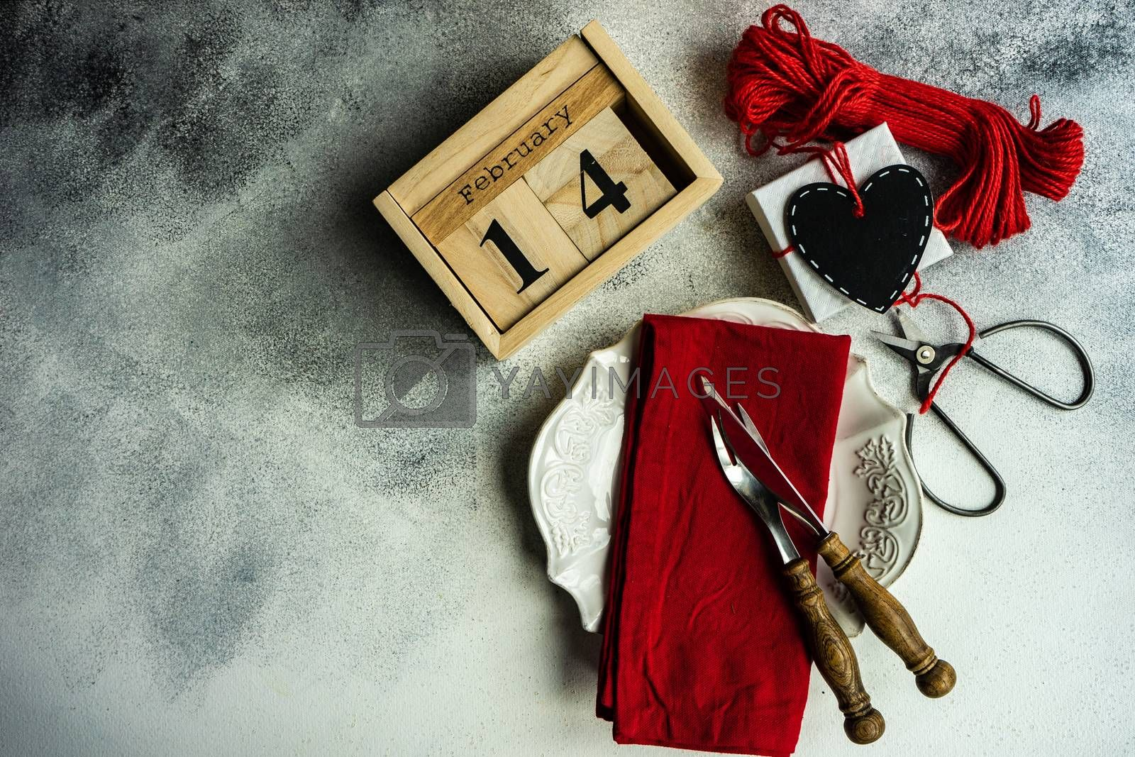 Place setting for festive dinner in St. Valentine day on concrete background with copy space