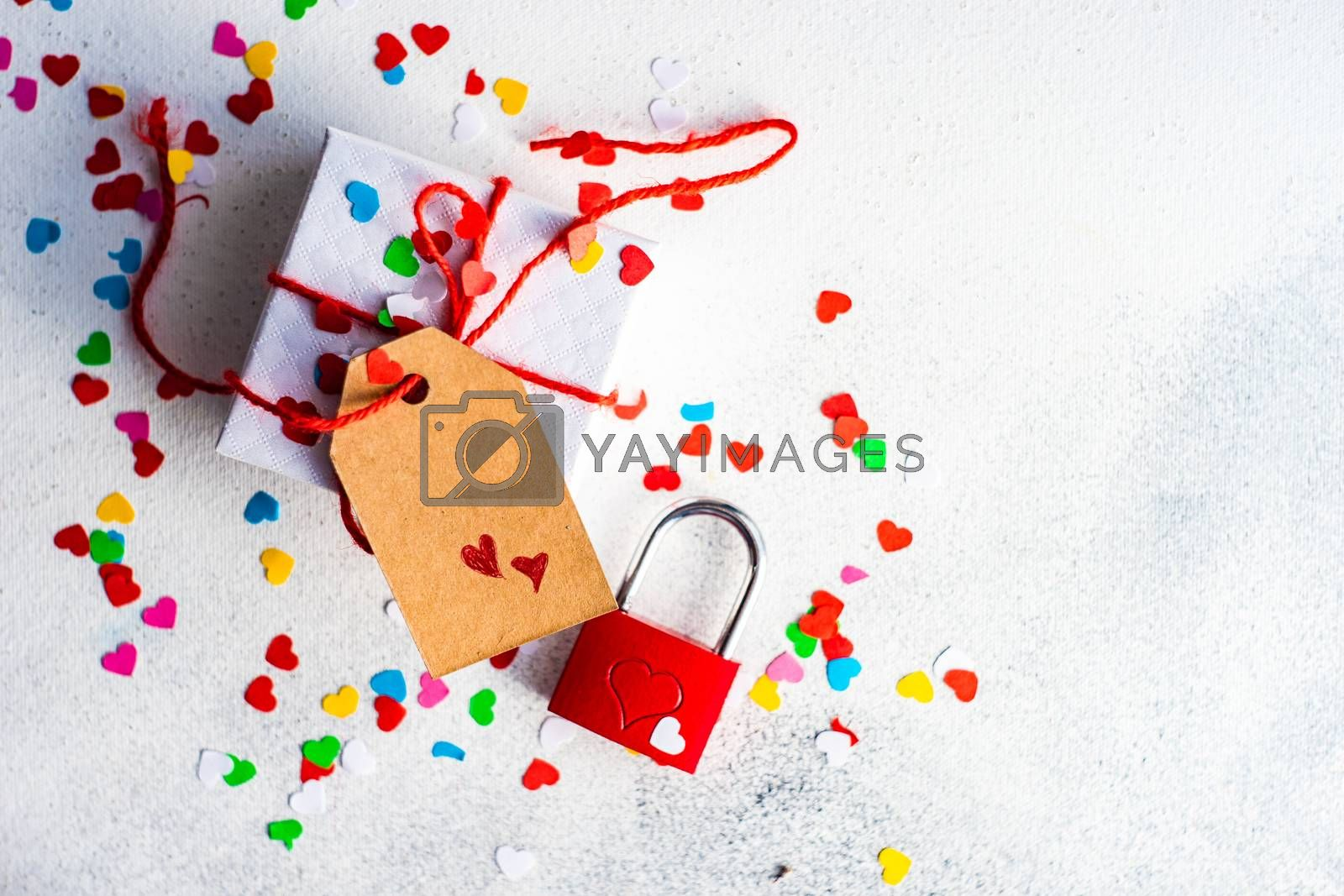 St. Valentine Day concept with white gift box with hearts and tag