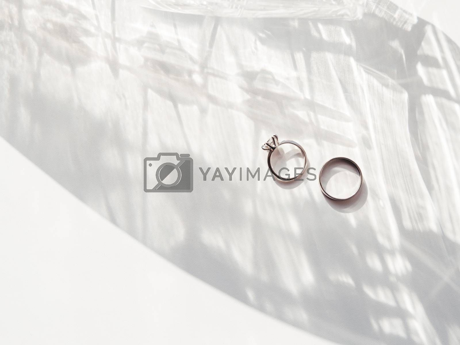 Top view on wedding and engagement rings with diamond. Symbol of by aksenovko