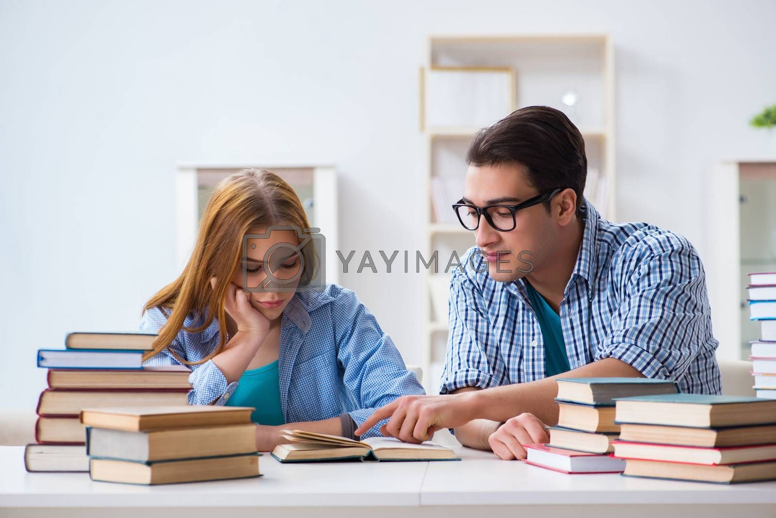 Pair of students studying for university exams