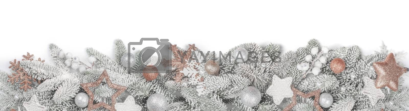 Frosted fir tree twigs and Christmas decorative bauble balls isolated on white background with copy space for text template flat lay top view design