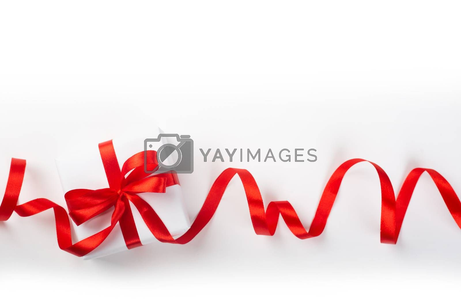 White holiday present gift box with red satin bow and curly ribbon border frame design isolated on white background , Christmas, Valentines day