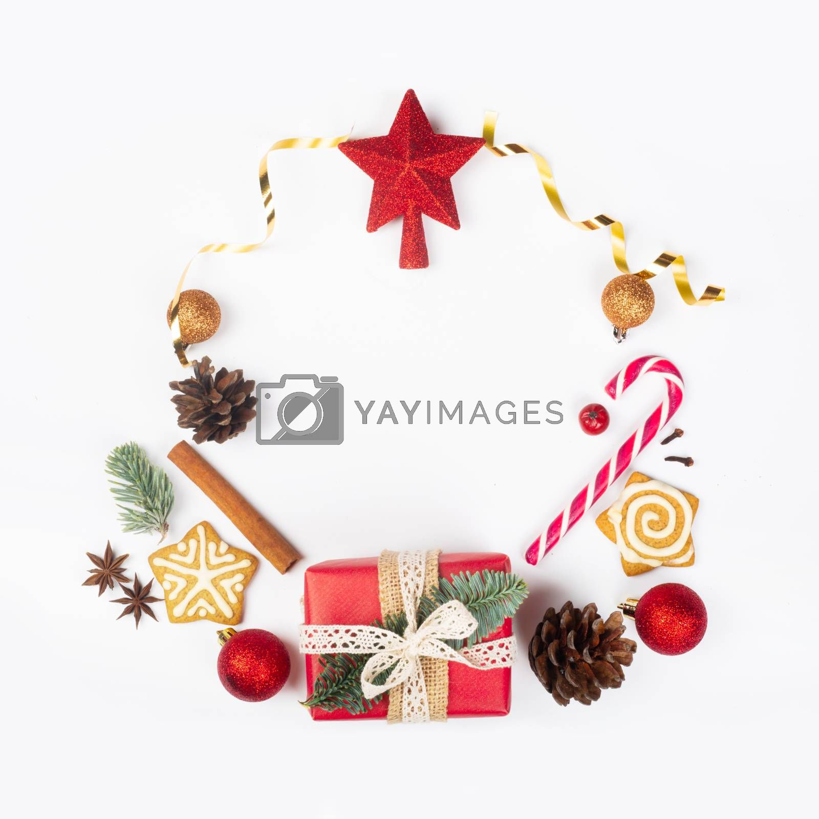 Minimalistic Christmas flat lay wreath composition of objects design top view on white background. New Year concept.